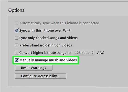 check the manually manage music and videos box